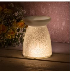 this ceramic based wax/oil burner features a charming embossed tree of life and heart decal