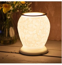 Covered with an array of embossed butterflies, this gorgeously simple ceramic lamp provides a bright and warming glow t
