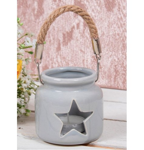 Grey toned ceramic T-light holder with star cut window . Simple and Charming, perfect for any themed space at Christmas