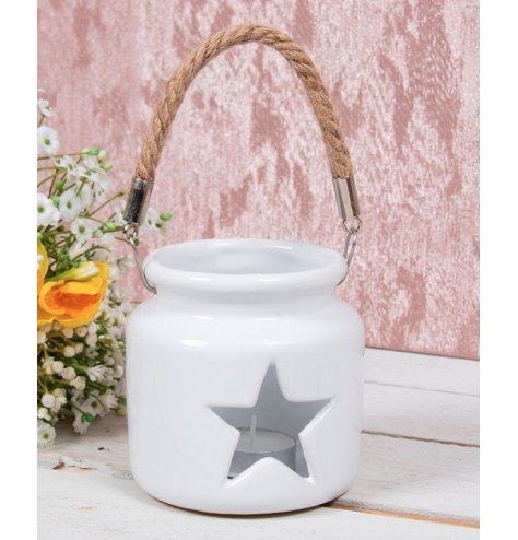 White toned ceramic T-light holder with star cut window . Simple and Charming, perfect for any themed space at Christmas