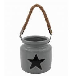 A charming little grey ceramic tlight holder with a small star cut decal