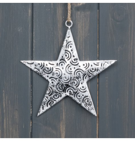 A small hanging metal star set with a distressed silver coating and added trim details