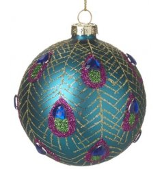 Sure to bring a luxe touch to your tree decor this festive season , a blue toned glass bauble with a glitter detail and
