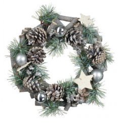 a round wreath covered with silver accents and woodland trimmings