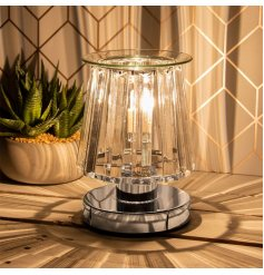 A stunningly designed Desire Aroma Lamp featuring a Silver Base Tone and added opaque glass panelling sides