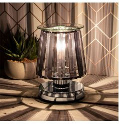 A stunningly designed Desire Aroma Lamp featuring a Silver Base Tone and added opaque black glass panelling sides