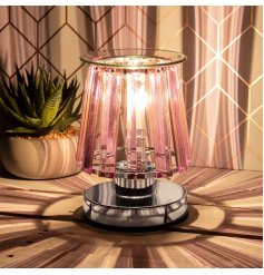 A stunningly designed Desire Aroma Lamp featuring a Silver Base Tone and added opaque pink glass panelling sides