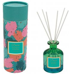 A pretty green and blue ombre toned glass diffuser filled with a delightfully scented liquid sure to create a fruity an