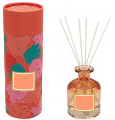 A pretty orange ombre toned glass diffuser filled with a delightfully scented liquid sure to create a fruity and fresh