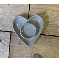 A charmingly simple heart shaped ceramic dish featuring a tlight holder space