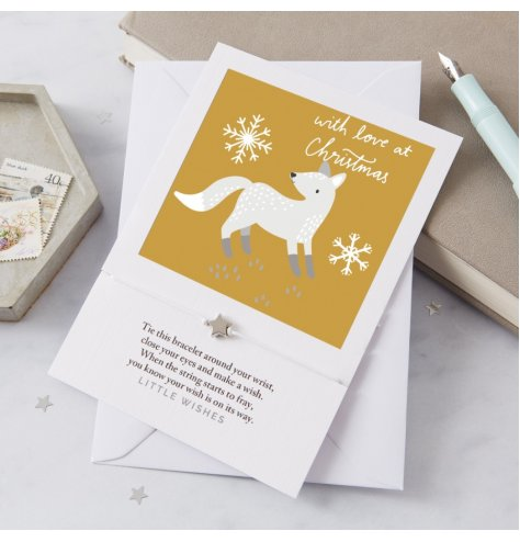 A simple printed card with a single silver star charm bracelet attached to it, perfect for gifting to any loved one at C
