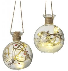 Sure to bring a cozy glow to any home space, an assortment of filled glass baubles with added LED lights and artificial