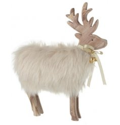 a standing wooden reindeer with a soft white faux fur body and jingle bell to finish