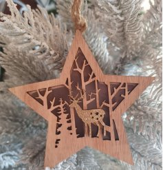 A charming wooden hanging star with a cut out woodland scene centre and illuminating warm glow from within