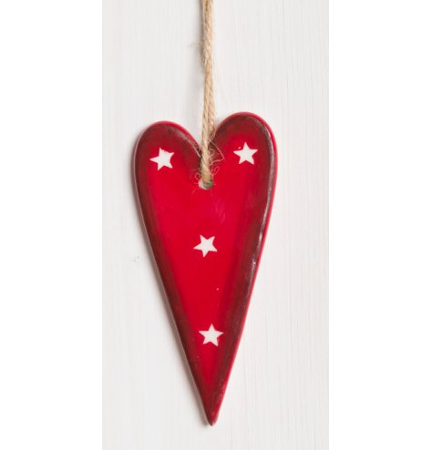 A shabby chic style red and white star heart Christmas decoration, complete with a chunky rope hanger.