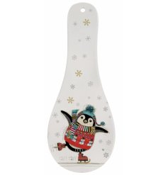 this silly skating penguin printed spoon rest is a must have for the Christmas Season at home