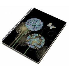 An A6 sized hardback notebook with a spiral edge and a beautifully vibrant coloured butterfly and flower print
