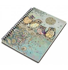 An A6 sized hardback notebook with a spiral edge and a beautifully coloured owl in tree print