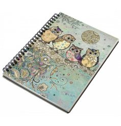 An A5 sized hardback notebook with a spiral edge and a beautifully coloured owl in tree print