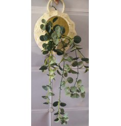 A simple yet chic hanging woven basket with an artificial draping eucalyptus set within it