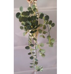 Sure to spruce up any empty corner of your home, a woven macrame basket with an artificial draping eucalyptus within it