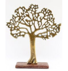 a natural wooden block based ornament set with a vintage gold toned aluminimum tree stood atop it