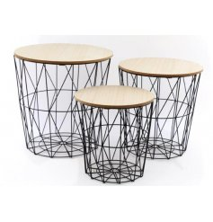 An assorted sized set of wire geo tables with natural wood tops