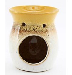 A large porcelain based tlight holder featuring a ombre toned colouring and speckled glaze finish