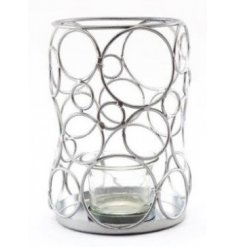A quirky metal frame candle holder featuring assorted sized circle decals