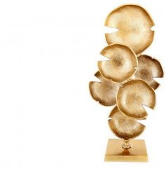 a large decorative sculpture with an abstract look and golden luxe tone