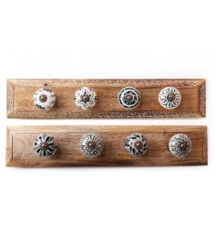 , this assortment of wooden coat hooks are perfect for any home with a rustic setting