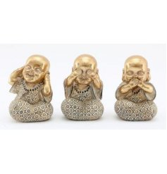 an assortment of golden buddha figures with the See, Hear and Speak No Evil poses