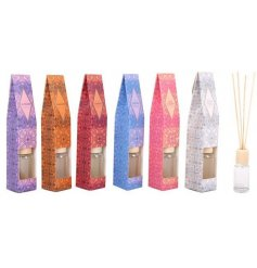 A gorgeous assortment of individually packaged reed diffusers, each set with its own coloured packaging and sensual sce