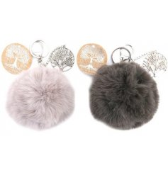 An assortment of fuzzy faux fur pompom keyrings, each with its own trendy colour and silver tree of life charm