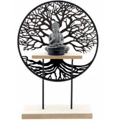 an ornamental Tree of Life and Buddha ornament with a small tlight holder space