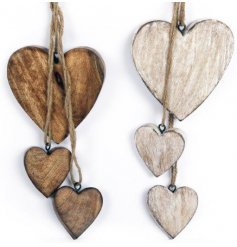 an assortment of light wood and dark wood heart hanging decorations