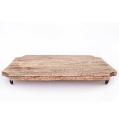 A large natural wooden chopping board with hairpin inspired legs