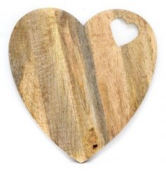 A natural wooden chopping board set in a sweetheart shape