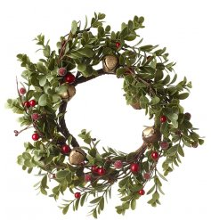 Sure to bring a traditional touch to your Christmas Decor, a round green foliage wreath with added berries and bells