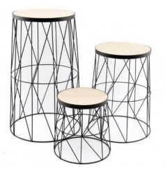 An assorted sized set of side tables, each featuring a trendy wire geometric design and smooth wooden top finish