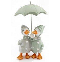 An adorable duo of cuddling duckies hidden under an umbrella