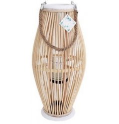 A natural wooden lantern complete with added white trimmings and a rustic rope handle
