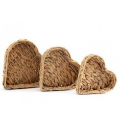 An assorted sized set of heart shaped woven hyacinth trays