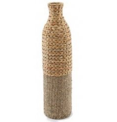 Set with a woven bamboo and seagrass decal, this ornamental vase will be sure to bring a Simplistic charm to any home s