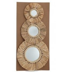 An assorted sized set of round mirrors each featuring a beautiful woven grass decal