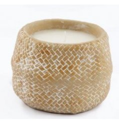 Set with a woven inspired decal, this rough edged candle pot is filled with a lightly fragranced wax centre