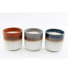 an assortment of 3 ceramic candle pots each filled with a sweetly scented wax