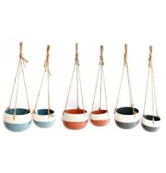 An assortment of two toned hanging planters, each set has its own basic colour tone