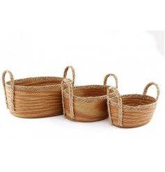 an assorted sized set of woven baskets with a burnt orange hue to each