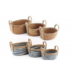 An assorted sized set of orange and blue woven baskets.